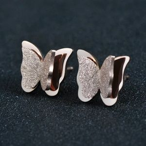 Silver stainless steel butterfly earrings.